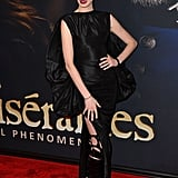 Anne Hathaway made a jaw-dropping arrival at the New York premiere of Les Misérables in head-to-toe Tom Ford that featured a stem-flaunting slit and a taffeta cape at the back.