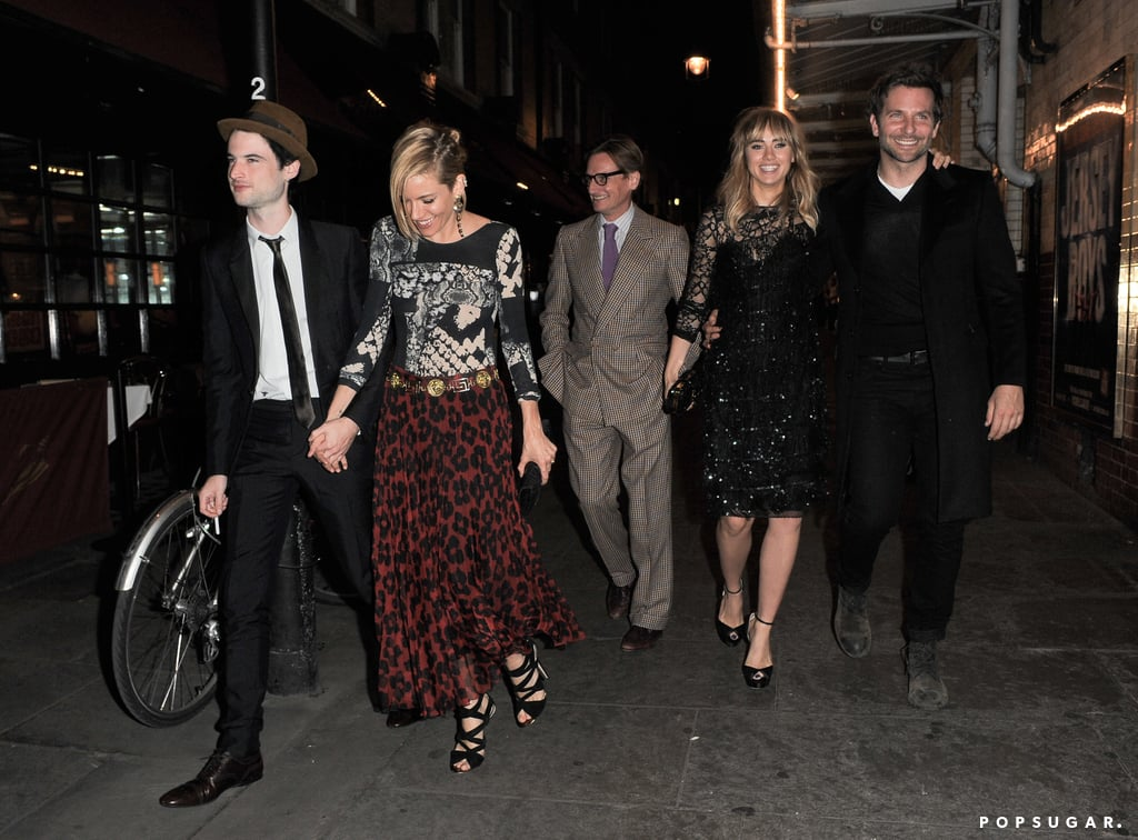 Bradley Cooper and Suki Waterhouse made for quite a stylish sight when they attended a London Fashion Week party on Monday alongside Bradley's stylish costar Sienna Miller and her main man, Tom Sturridge. The group was spotted chatting and laughing as they left a dinner at J. Sheekey. They were joined for their swanky meal by Anna Wintour and Vogue Editor at Large Hamish Bowles. Bradley and Suki didn't stop their Fashion Week partying after dinner as they dropped by another bash later that night where Suki met up with her model friend Cara Delevingne and her sister, Poppy Delevingne. While Bradley has been busy with filming for most of the year, he has been taking a backseat to his model girlfriend over the past few days while she works during her hometown's week of fashionable events.
