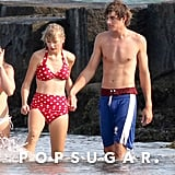Bikini-Clad Taylor Swift Holds Hands With Conor Kennedy on the Cape