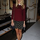 Poppy Delevingne added metallic heels to a sweet skirt and sweater at the Fashion East show in London.