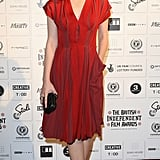 Carey Mulligan looked effortlessly chic in a pleated Bottega Veneta number with statement accessories — black caged sandals and a woven Bottega Veneta clutch — at the British Independent Film Awards 2009 in London.