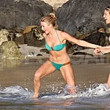 Julianne Hough and her friend played in the waves in their bikinis.
