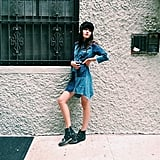 A patchwork denim dress is eye-catching enough as it is. But studded moto boots and a schoolboy hat balance out the power of your statement outfit. Source: Instagram user natalieoffduty