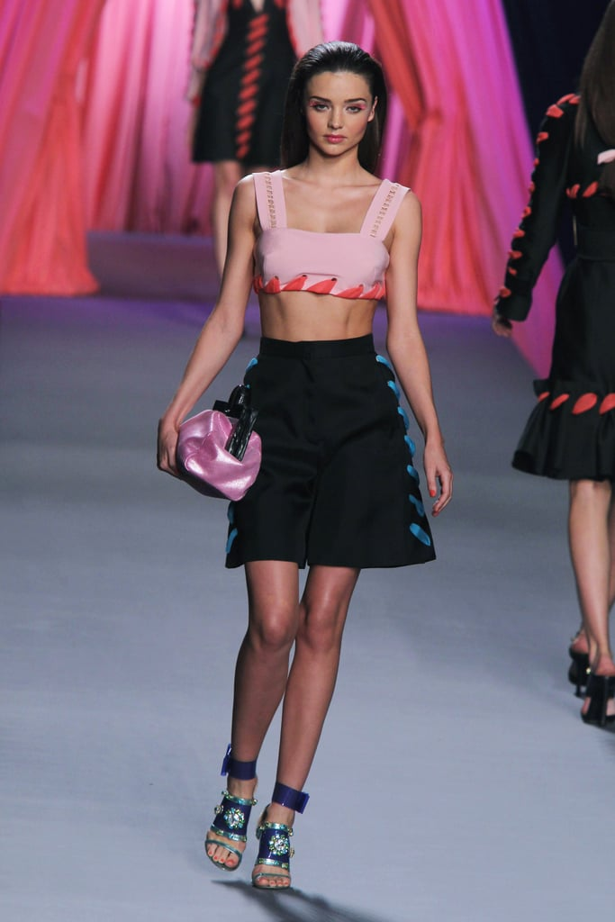 During the Viktor & Rolf Spring 2012 show, Miranda was a living doll in a colorful cropped look.