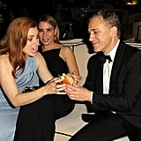 Amy Adams happily took a burger from Christoph Waltz during the Weinsten Company afterparty.