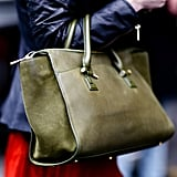 A closer look at this style-setter's olive-green satchel.