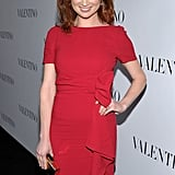 Ellie Kemper wore a red dress with a ruffle down the side to Valentino's 50th anniversary party in LA.