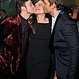 Peter Facinelli and Jackson Rathbone planted big ones on Elizabeth Reaser at the Breaking Dawn afterparty.