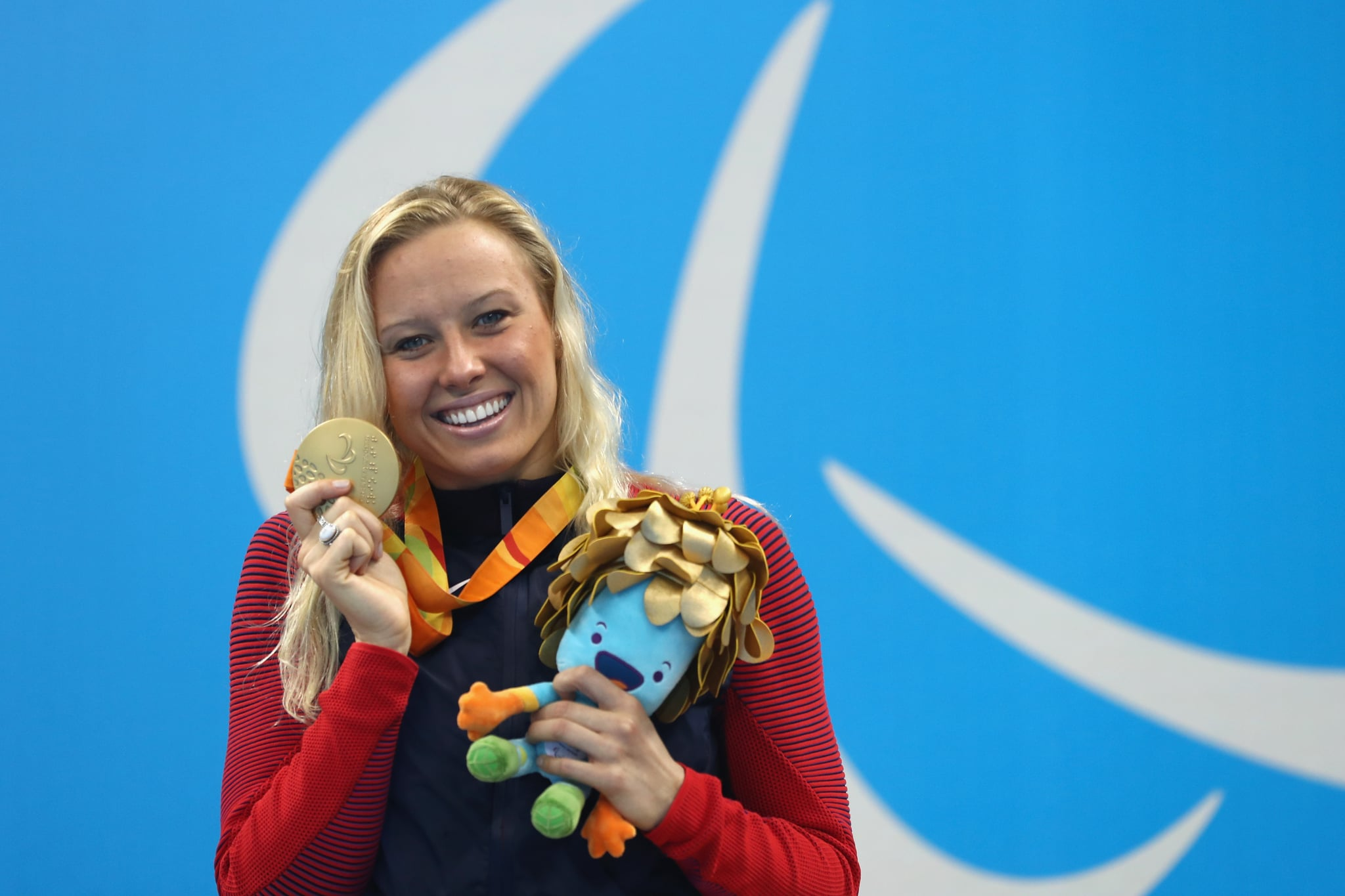 RIO DE JANEIRO, BRAZIL - SEPTEMBER 17:  Gold medalist Jessica Long of the United States celebrates on the podium at the medal ceremony for Women's 200m Individual Medley - SM8 on day 10 of the Rio 2016 Paralympic Games at the Olympic Aquatics Stadium on September 17, 2016 in Rio de Janeiro, Brazil.  (Photo by Buda Mendes/Getty Images)