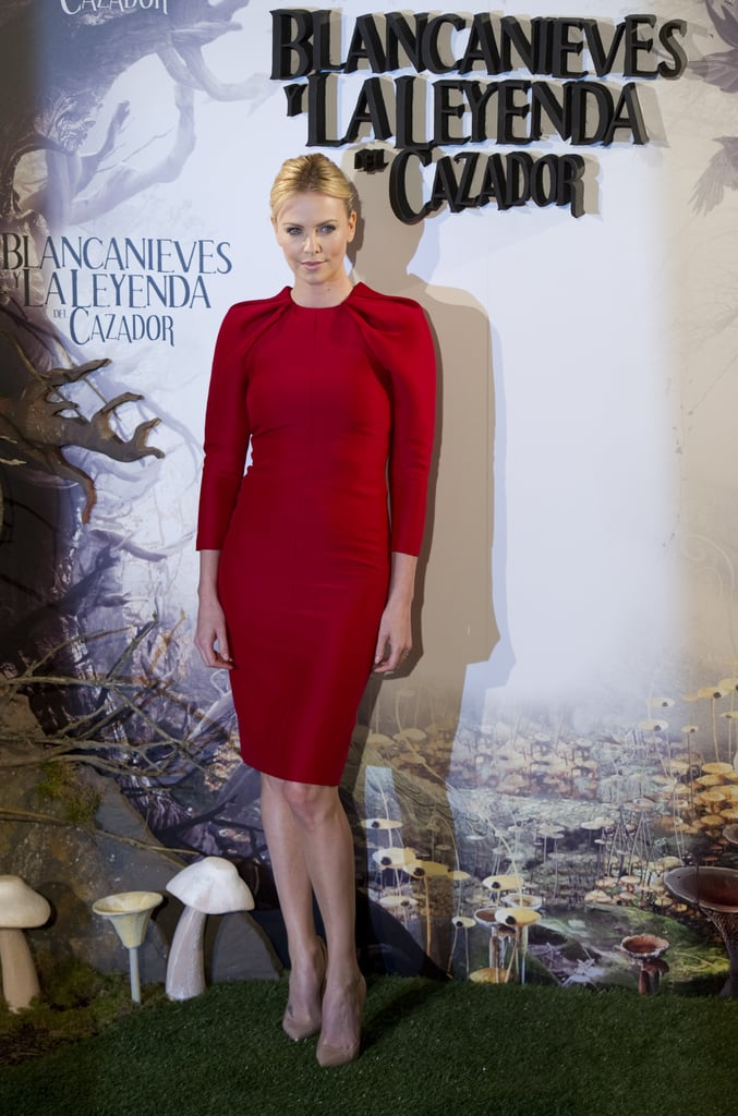 Charlize Theron looked sexy in a red dress at the Snow White and the Huntsman photocall in Madrid.