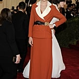 For the 2012 Met Gala, Kirsten showed up in an orange blazer and dress set from Rodarte.