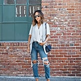 A White Top, Distressed Boyfriend Jeans, a Waistcoat, and Loafers