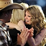 Taylor's mom congratulated her as she won entertainer of the year during the Academy of Country Music Awards in April 2011.