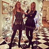 Paris and Nicky Hilton posed in front of their Christmas tree.