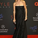 Rachel Zoe showed off her growing baby bump in a black dress at the Style Awards.