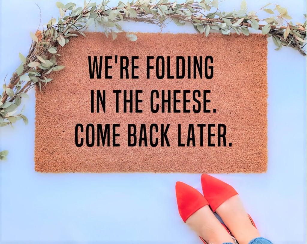 We're Folding In The Cheese Doormat