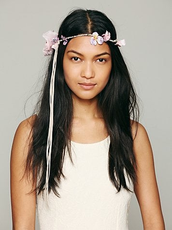 Nothing says carefree hippie (but not cheesy) bride like Free People's Madeline floral halo ($58) headpiece.