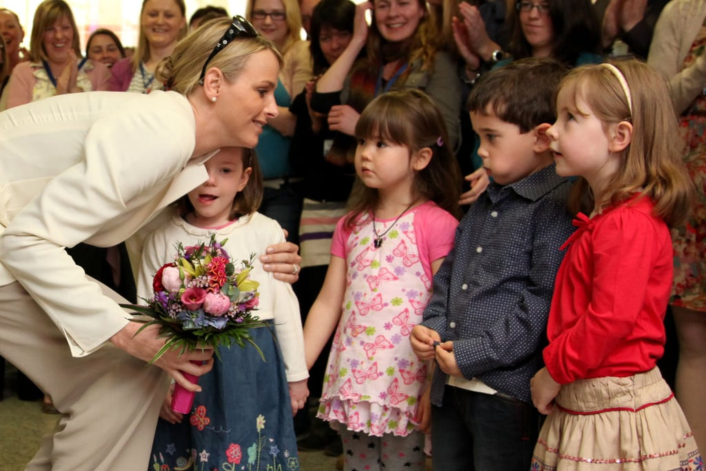 Princess Charlene was presented with flowers from children during a visit to Ireland in April 2011. Source: Getty / Maxwells Dublin/Pool