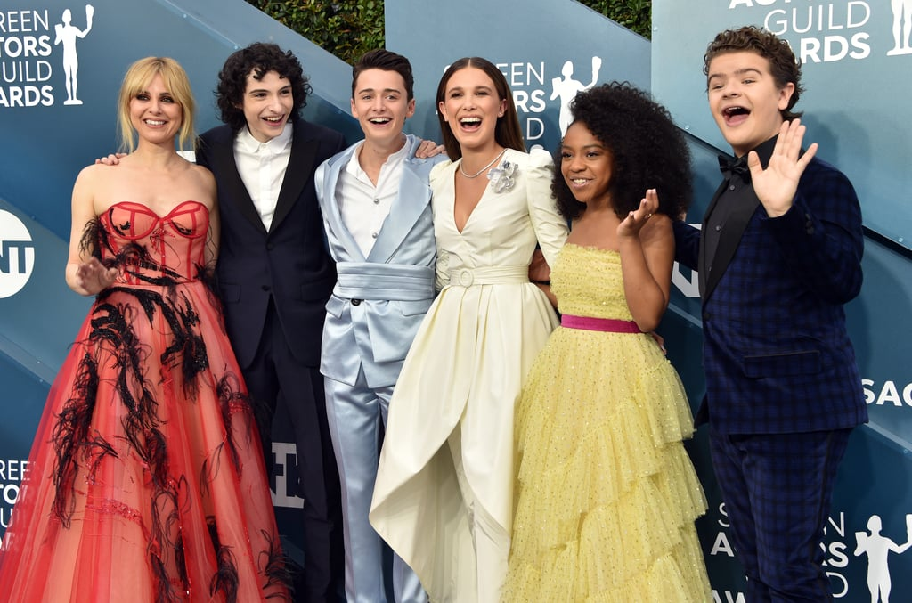 "The Stranger Things cast is officially back together again! On Sunday night, the stars of the Netflix series were in full force as they attended the SAG Awards. While Dacre Montgomery and his girlfriend Liv Pollock cuddled up for the cameras, Cara Buono, Finn Wolfhard, Noah Schnapp, Millie Bobby Brown, Priah Ferguson, and Gaten Matarazzo all posed for a big group photo. Like the stars mentioned on the red carpet, this is actually the first time many of them have seen each other since the show's big season three premiere in June 2019.  It's sure to be a fun night for the young stars. Not only are they are up for outstanding performance by an ensemble in a drama series, but they are expected to start filming season four very soon. While chatting with People TV, Noah Schnapp teased that he's already read the script for the first four episodes. ""I can't say anything about it, but it's going to be good."" See more of their night ahead."