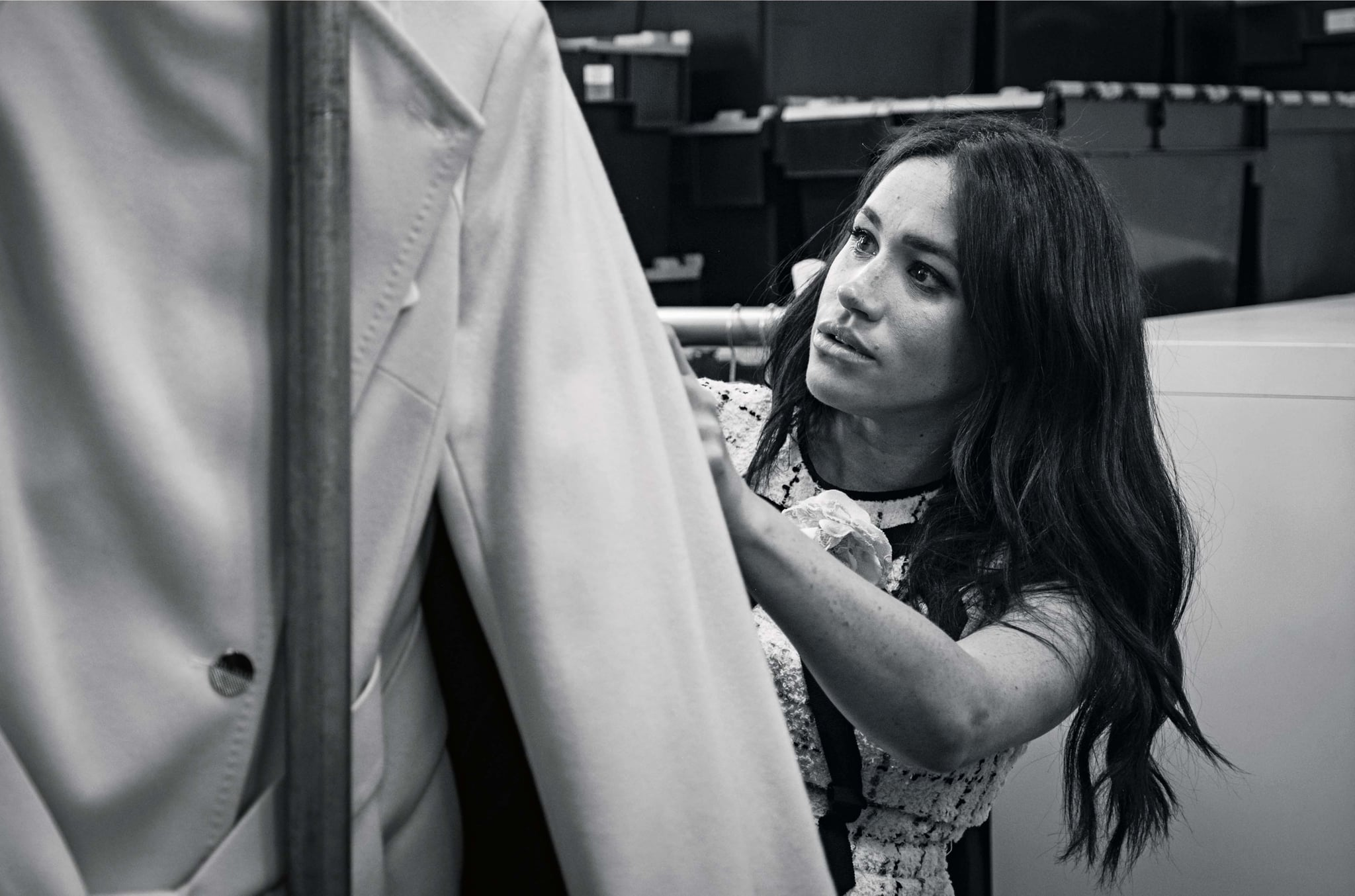 This undated handout photo issued on July 28, 2019 by Kensington Palace shows Britain's Meghan, Duchess of Sussex, Patron of Smart Works, in the workroom of the Smart Works London office. - Prince Harry's wife Meghan will guest edit the September issue of iconic fashion magazine British Vogue, which will see her in