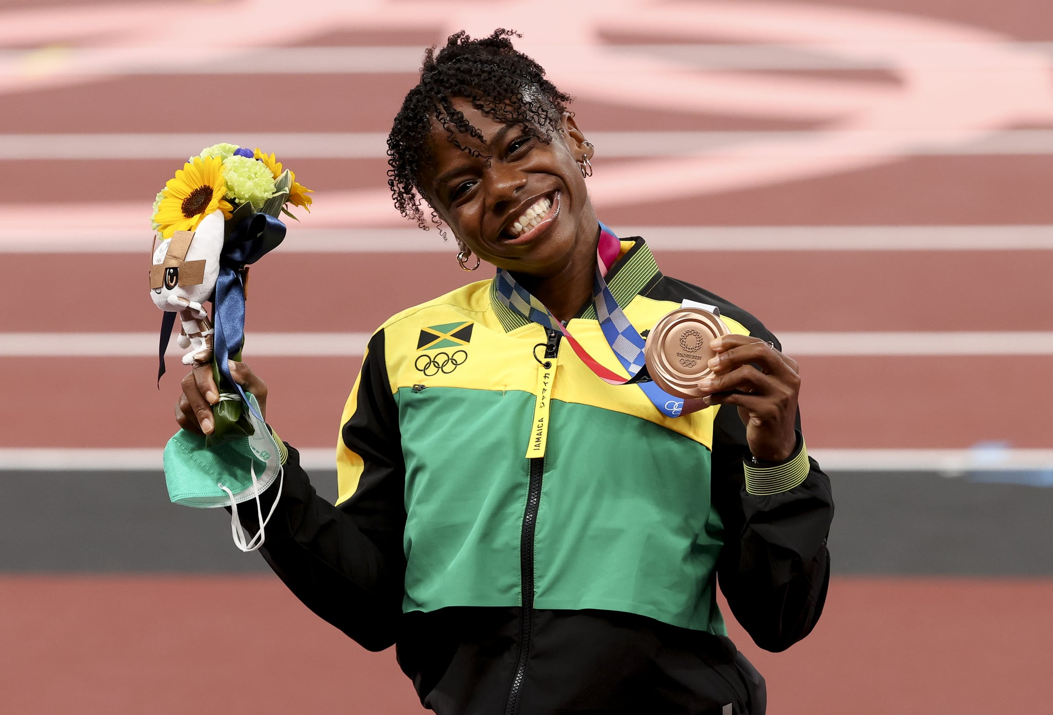TOKYO, JAPAN - AUGUST 2: Bronze Medalist Megan Tapper of Jamaica during the medal ceremony of the Women's 100m Hurdles on day ten of the athletics events of the Tokyo 2020 Olympic Games at Olympic Stadium on August 2, 2021 in Tokyo, Japan. (Photo by Jean Catuffe/Getty Images)