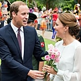 Prince William presented Kate Middleton with flowers during a September 2012 stop in Kuala Lumpur.