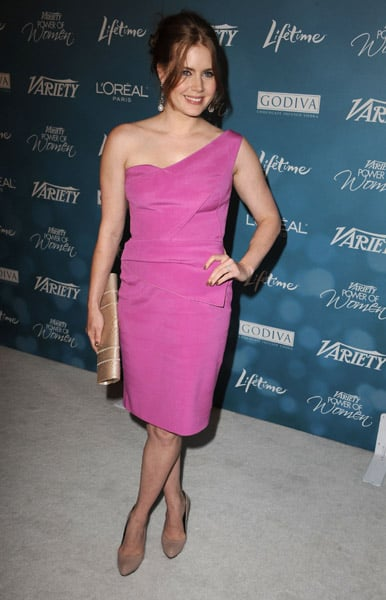 Amy looked elegant in a pink one shoulder number with neutral accessories.