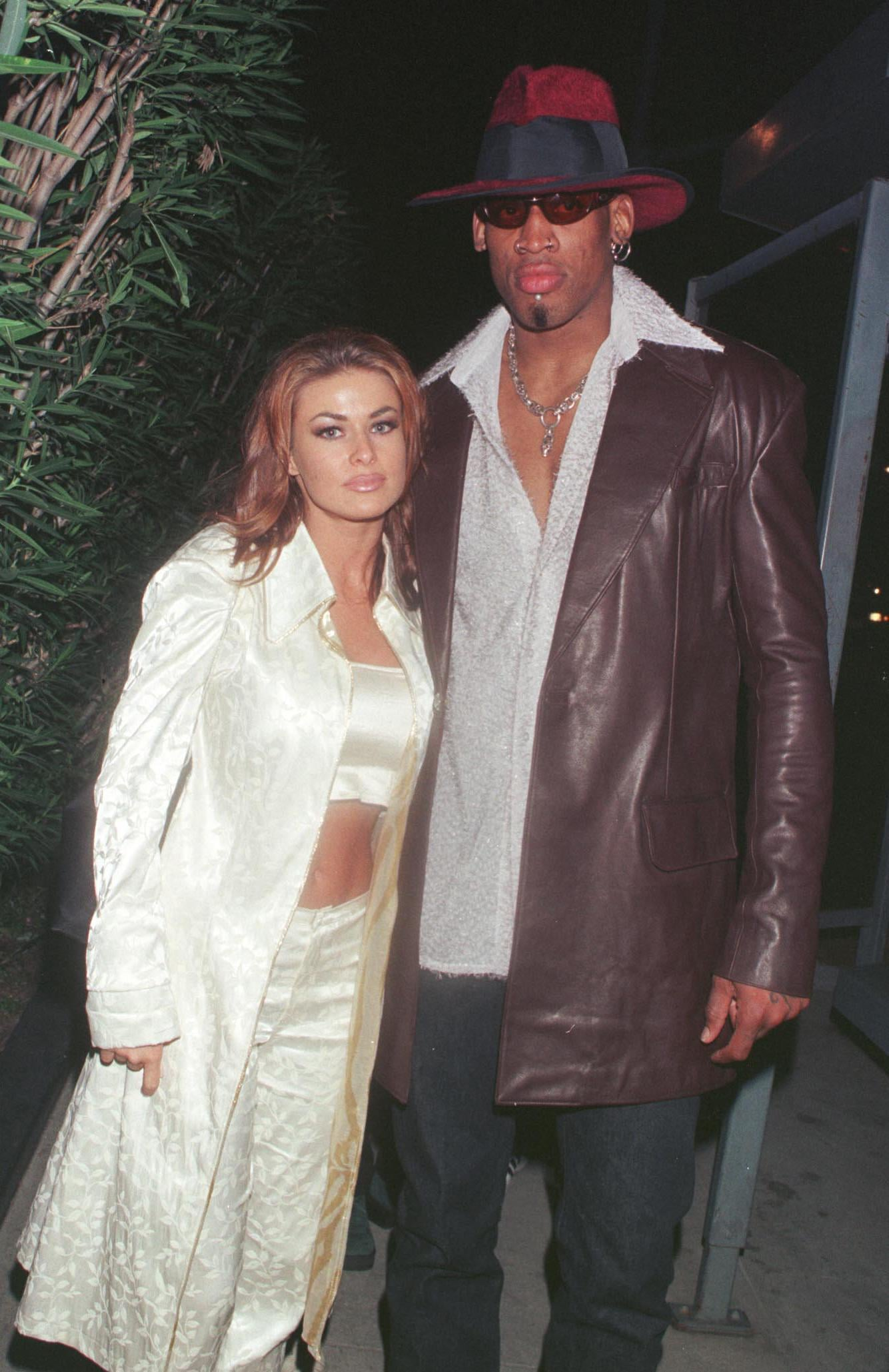 2/26/99 Beverly Hills, CA. New Laker Dennis Rodman celebrates his first winning game out on the town at GOODBAR with wife Carmen Electra.
