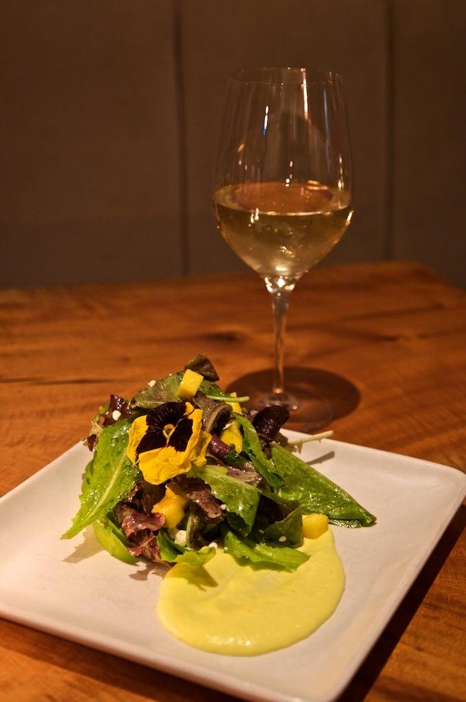 Avocado and mango salad with baby greens, barrel aged feta, white balsamic vinaigrette