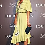 For an appearance at the Louis Vuitton Timeless Muses event, Kate Moss chose a 30s-inspired yellow dress with butterfly sleeves and a fluted hem.