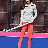 Kate has jeans in every color by her favorite high street brand, Zara, but for hockey practice with the Olympics team, she opted for coral.