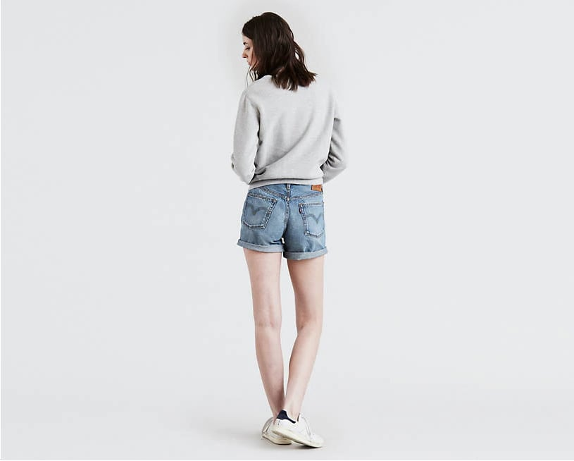 The waist sits just above the belly button, so they're comfortable and flattering. No muffin top! The slightly faded, subtly distressed denim and relaxed fit make them feel like a vintage pair of denim shorts that have been perfectly worn in.