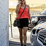 For a day of errands, Reese chose a black skort, leopard Gianvito Rossi sandals, and her trusty fedora.