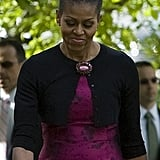 Michelle Obama finished off her Easter Sunday look with an elegant purple brooch pinned to her cardigan.