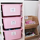 Socks and Underwear: my girls share these items, so for these I made a separate unit using Target Pillowfort Stackable Wood Bins and labeled them accordingly.