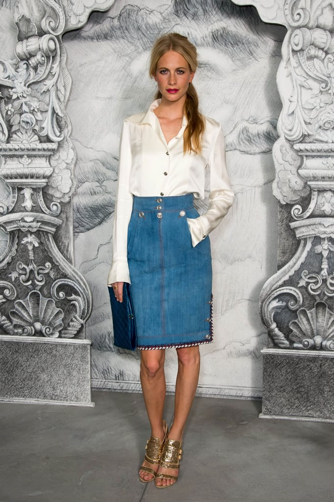 Poppy Delevigne gave a denim skirt a chic makeover with a silky white button-down and gold-tinged heels at Chanel.