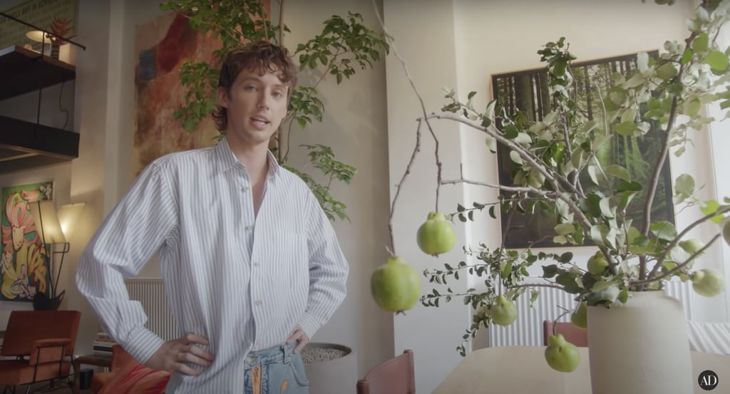 "Troye Sivan's sunny Melbourne home combines the retro vibes of the '70s with a blend of modern art that would definitely make this one of the coolest Airbnb's around — if it were on the market. The singer recently gave Architectural Digest a tour of the Victorian-era home and showed off a few of the ways he's made it his own. He also revealed the ""dream home"" was formerly a brick factory and a handball court before architect John Mockridge renovated it in the '70s, giving it the textured woodgrain walls, lofted cork board ceilings, floor-to-ceiling windows and angular design it has today.  ""I've always worshipped the idea of home,"" Troye captioned a post on Instagram. ""I wrote my first album when i left Perth at 18 and have longed for that feeling ever since. Always felt torn between special places and people, but not feeling like i really belonged in any of the environments i found myself in — until now, when i feel like i needed it most."" Vintage decor, unique art pieces, and soft lighting add a tranquil yet artistic energy to the home, balanced out by the beauty of the oasis-like courtyard. Take a full tour of Troye's house here.      Related:                                                                                                           Daveed Diggs and Emmy Raver-Lampman's Home Perfectly Matches Their Sunny Personalities"
