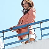 Eva Longoria peered over the balcony during her rooftop photo shoot at the Cannes Film Festival.