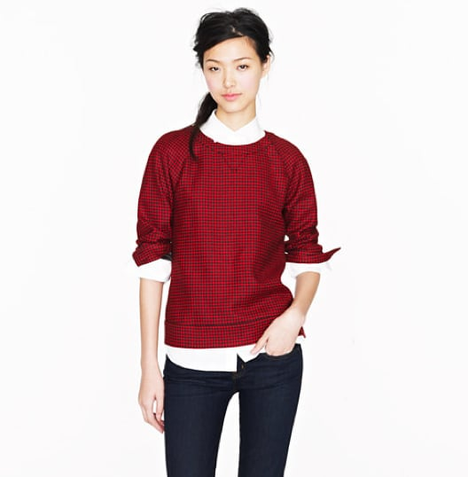 A festive, red-sheened topper with a classic houndstooth print provides the perfect amount of holiday dynamic, so you needn't do much else in the way of bold accessorizing. The best part? This piece really exists: J.Crew Collection houndstooth popover ($525).
