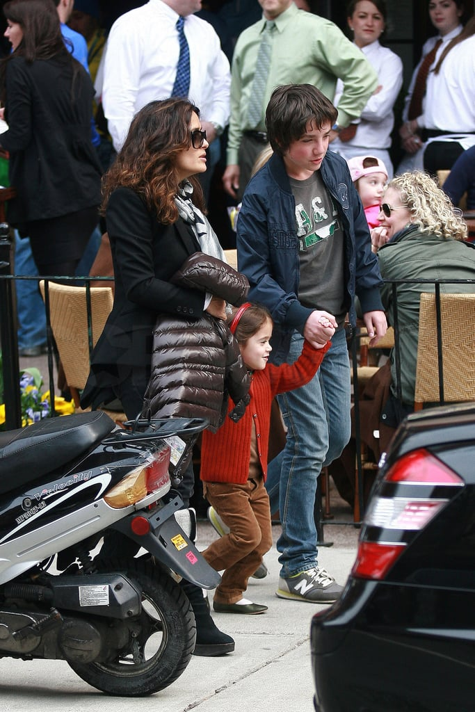 Salma Hayek held hands with her daughter, Valentina, who in turn clutched her half-brother Francois, yesterday following a lunch in Boston at Stephanie's cafe on Newbury Street. Her husband, Francois-Henri Pinault, was also on hand for the meal, and he left ahead of his family to wave over their car and driver. The Pinault-Hayek clan is currently based in Massachusetts while Salma shoots Here Comes the Boom with Kevin James. It's her second collaboration with Kevin after last year's Grown Ups, which they starred in with Adam Sandler. Work has taken Salma to a few locations around the globe so far this year, since she left her home base in France for a stint on the set of another project in Spain during February. She and Valentina arrived in the Northeast earlier this month to get settled before shooting began. The big-screen endeavors haven't stopped Salma from exploring other outlets, though, and her beauty line Nuance by Salma Hayek is expected to be in CVS stores soon.