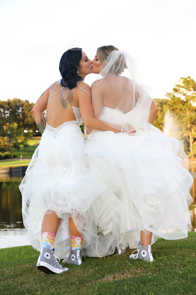 "We Love How This Couple Wore ""Bride"" Converse Sneakers Under Their Wedding Gowns"