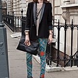 A no-fail outfit for Fashion Week? Floral pants, an oversize clutch, and a tailored tuxedo blazer.