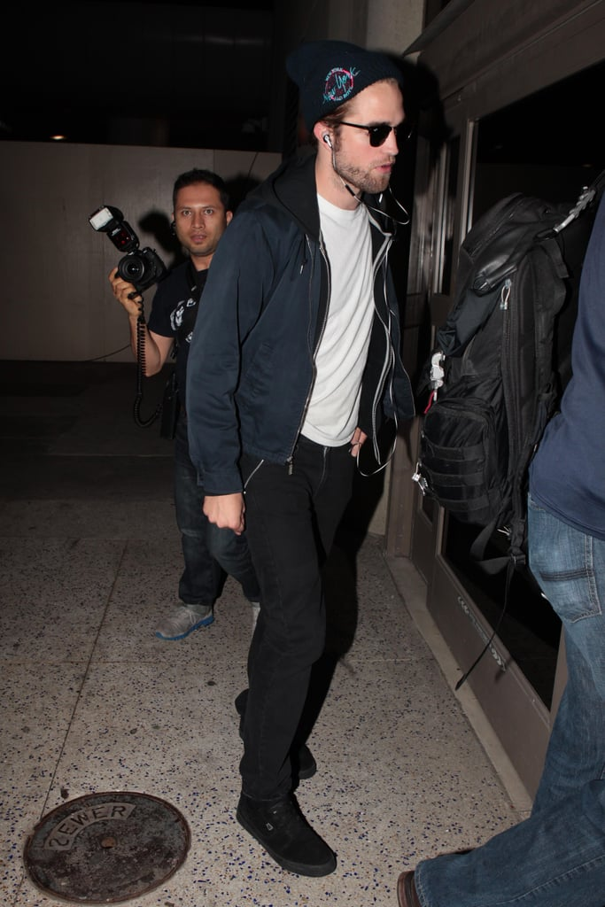 Robert Pattinson arrived at LAX on Friday night ready to take a flight out of town. He made his way to Australia, where he's due to begin a promotional tour for Breaking Dawn Part 2, which includes a fan event this afternoon. Robert will travel the world in the month leading up to the final Twilight film's release, and he'll have the company of a rotating cast of co-stars during various premieres and press days. He's not the only one heading off to start promoting — Kristen Stewart's off to Japan, Taylor Lautner's going to Brazil, Ashley Greene will head to South Africa, and Kellan Lutz is due in Scotland and Ireland with Nikki Reed. They'll all be together for the big LA premiere. We'll see Rob and Kristen sharing their first red carpet since reconciling romantically. Robert and Kristen are apparently going strong, having stepped out publicly in California multiple times over the last week.