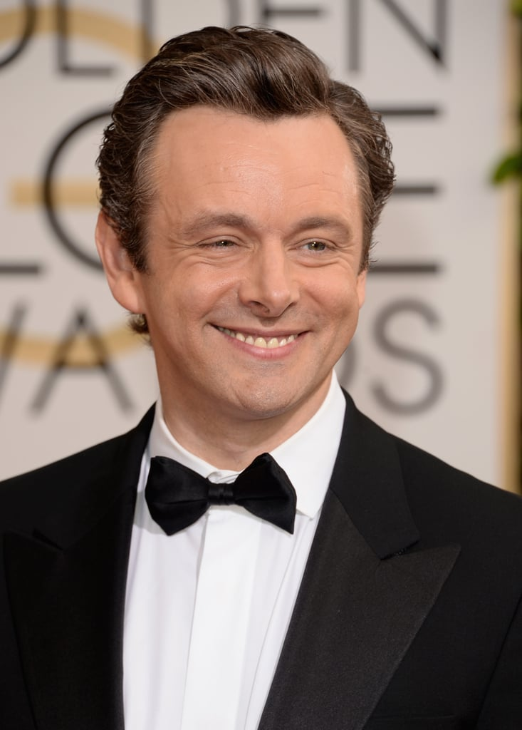 Michael Sheen stopped and smiled on the carpet.