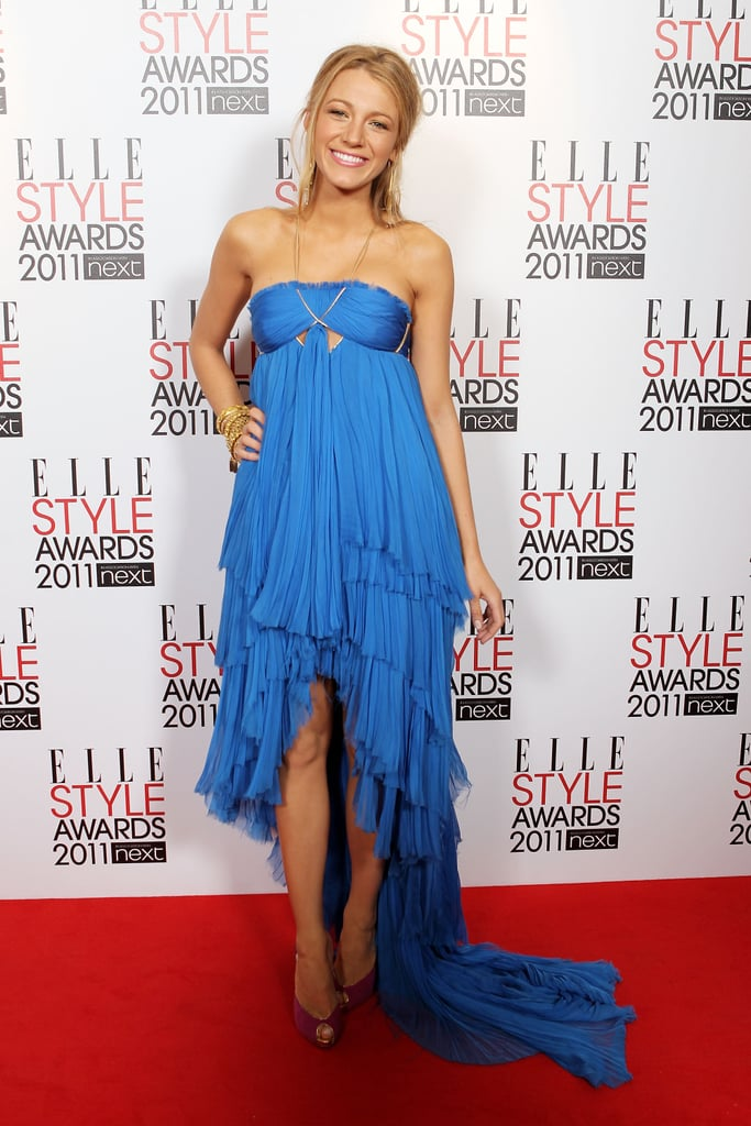 Wearing an Emilio Pucci strapless dress and Christian Louboutin heels to the 2011 ELLE Style Awards.