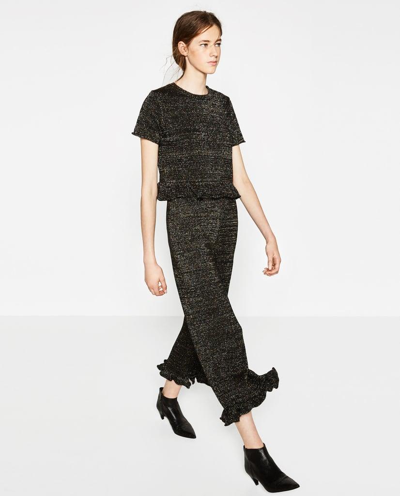 Zara سروال زارا ذو النهايات المكشكشة ($36) and كنزة صوفية بأكمام قصيرة مكشكشة ($30)