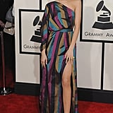 Zendaya embraced the rainbow at the 2015 Grammys in this one-shouldered gown by Vivienne Westwood.