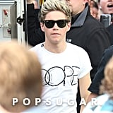Niall Horan wore sunglasses to the set of the new One Direction video shoot.