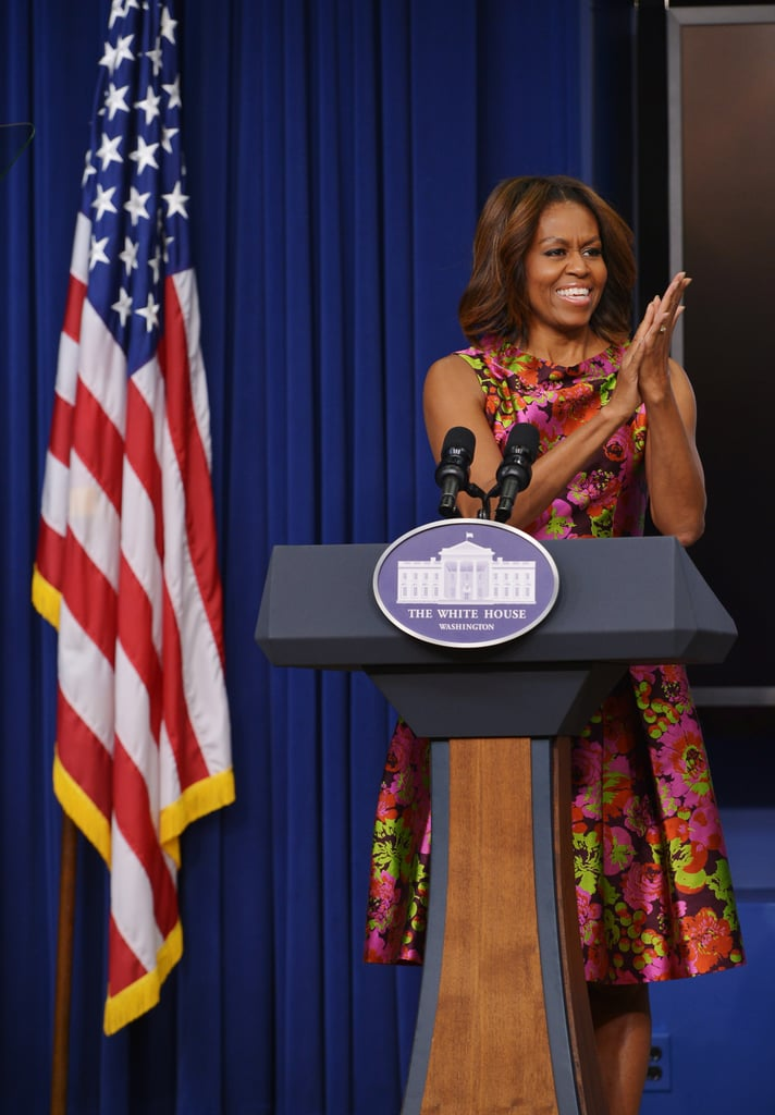 Michelle Obama applauded at the event.