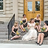 These bridesmaids wore black lace knee-length dresses.